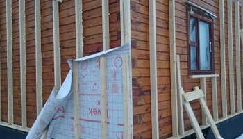 Утепление дома из бруса: выбор материалов и технологии
